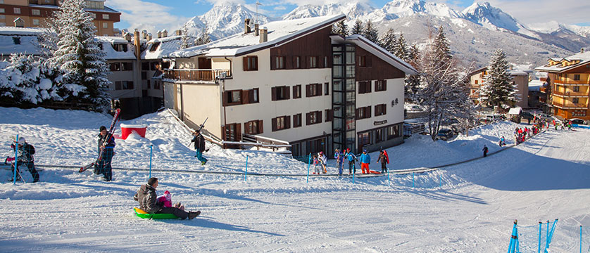italy_milky-way-ski-area_sauze-doulx_hotel-hermitage_exterior_nursery-slopes.jpg